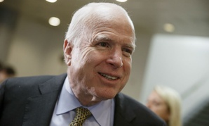 Republican Sen. John McCain accuses the service of shifting people around, rather than cutting overall jobs.