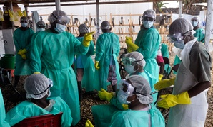 Health care workers inside a USAID, funded Ebola clinic with their Ebola virus protective gear in Monrovia, Liberia.