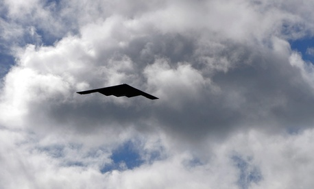 A B-2 Spirit strategic bomber conducts a low approach training flight over Hickam Air Force Base, Hawaii.