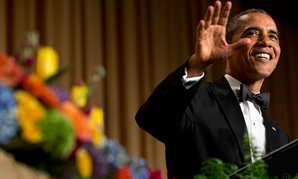 Obama waves during the 2014 White House Correspondents' Association Dinner.