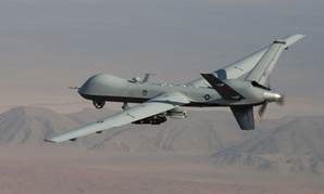 An MQ-9 Reaper, armed with GBU-12 Paveway II laser guided munitions and AGM-114 Hellfire missiles, piloted by Col. Lex Turner flies a combat mission over southern Afghanistan.