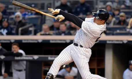 New York Yankees' Mark Teixeira hits a two-run home run during a game Friday.