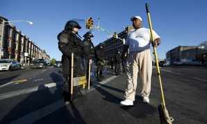 Victor Huntley-el thanks law enforcement officers as they stand guard Tuesday in Baltimore, in the aftermath of rioting.