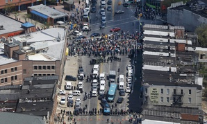 Police stand in formation near a gathering of protestors at the intersection of North Avenue and Pennsylvania Avenue in Baltimore Tuesday.
