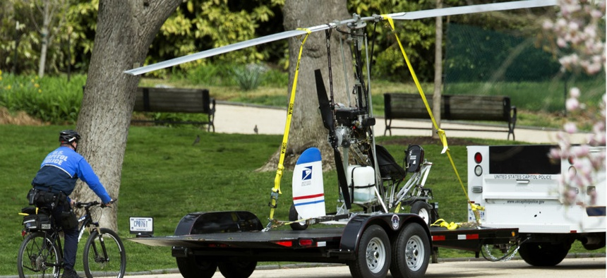 Capitol Police remove the small helicopter that Florida mail carrier Doug Hughes was able to land on the Capitol lawn April 15.