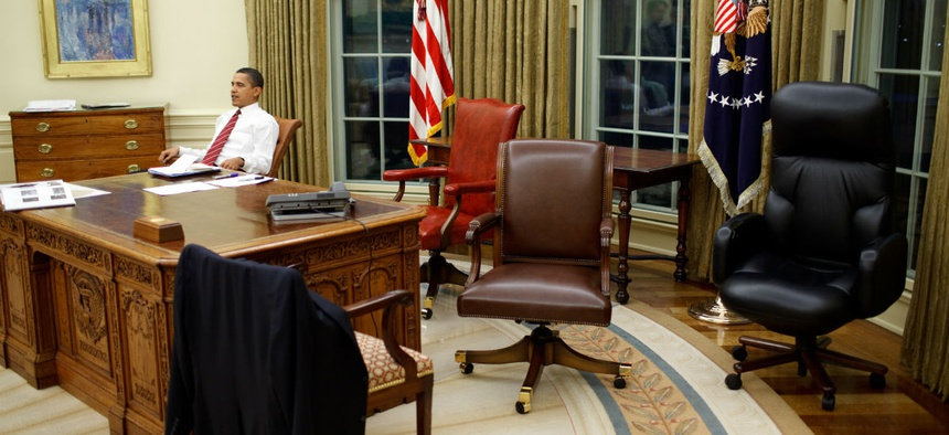 President Obama tries out different office chairs soon after being sworn in as President in 2009.