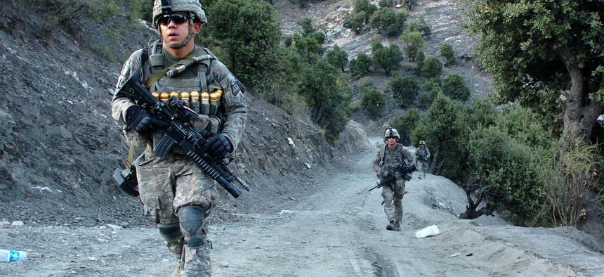 U.S. Army soldiers patrol the Korengal Valley in Afghanistan's Kunar province in 2009.