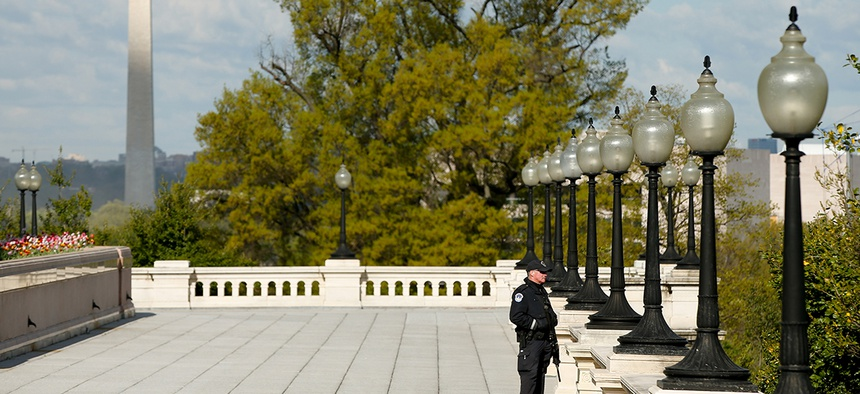 A Capitol Hill Police officer stands outside the Capitol in April.