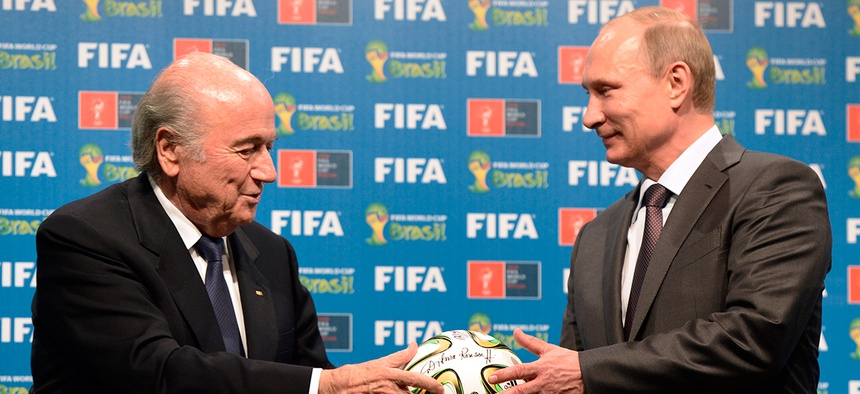 FIFA President Sepp Blatter, left, and Russian President Vladimir Putin are seen during the official ceremony of handover to Russia as the 2018 World Cup hosts in Brazil last summer.