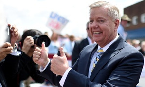 Graham greets supporters after his announcement Monday.