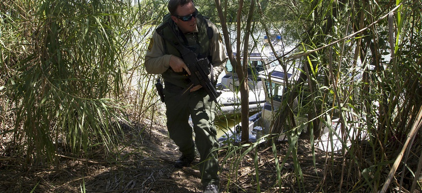 An agent patrols along the Rio Grande River.