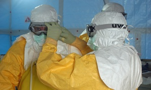 A CDC official get ready to enter an ebola treatment unit in 2014 in Sierra Leone.