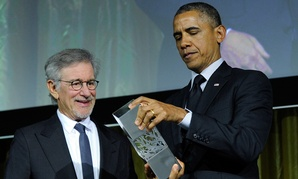Steven Spielberg presented the USC Shoah Foundation's Ambassador for Humanity Award to Barack Obama in 2014.