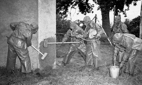 Students at an Army officer training school in England decontaminate the facility after a simulated mustard gas attack in 1942.