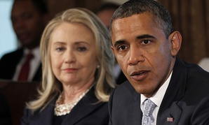Obama speaks at a cabinet meeting in 2012 as Clinton watches.