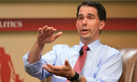 The build up of government jobs around Washington, D.C., has led to six of the 10 wealthiest counties in America being in the city's metropolitan area, said Republican presidential contender Scott Walker.