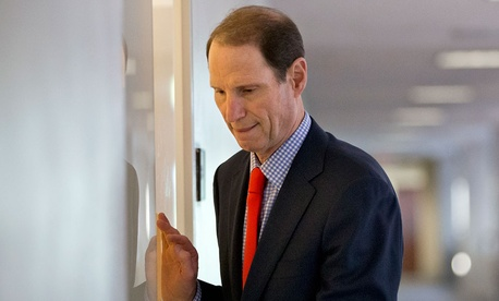 "Sen. Ron Wyden, D-Ore., has railed against the information-sharing legislation passed out of the Senate Intelligence Committee as a ""surveillance bill by another name."""