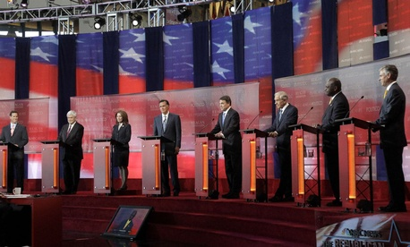 Republican presidential candidates line up on stage during a debate in 2011 in California.
