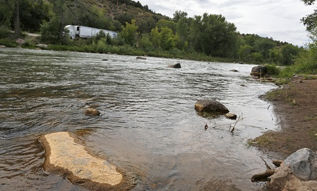 Dried yellow residue remains on a rock in the now-closed Animas River due to the Gold King mine chemical spill this week.