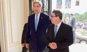 U.S. Secretary of State John Kerry and Cuban Foreign Minister Bruno Rodríguez enter the Cuban Ministry of Foreign Affairs in Havana Friday.