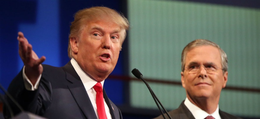 GOP presidential candidates Donald Trump (left) and Jeb Bush participate in the first Republican debate in August.