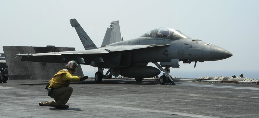 Lt. Cmdr. Craig Ryan launches an F/A-18F Super Hornet from the deck of the USS Roosevelt, which is supporting operations against ISIS.