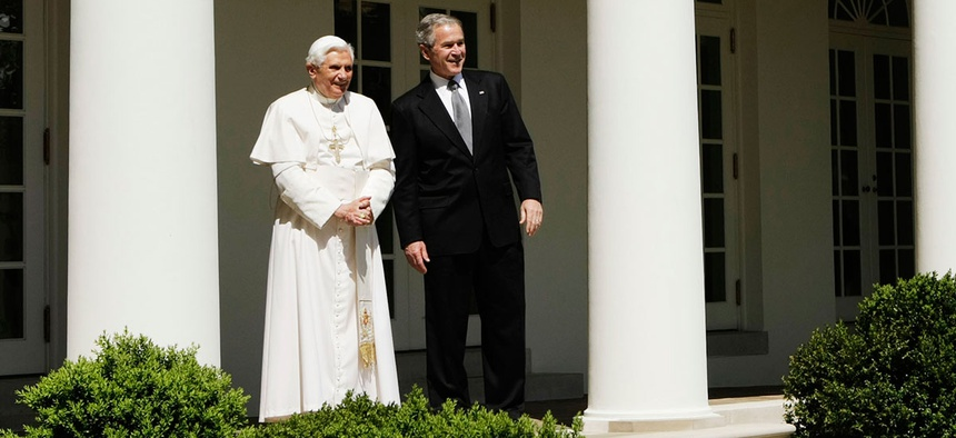 George W. Bush and Pope Benedict XVI stand outside the Oval Office in 2008.