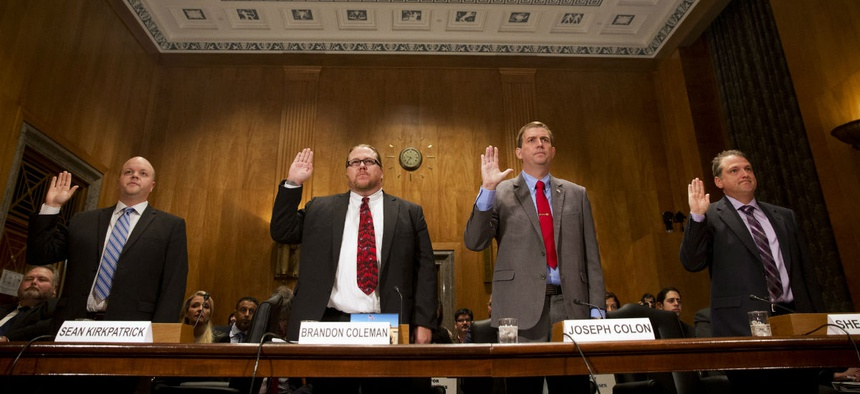VA whistleblowers are sworn in before a hearing of the Senate Homeland Security and Governmental Affairs Committee.