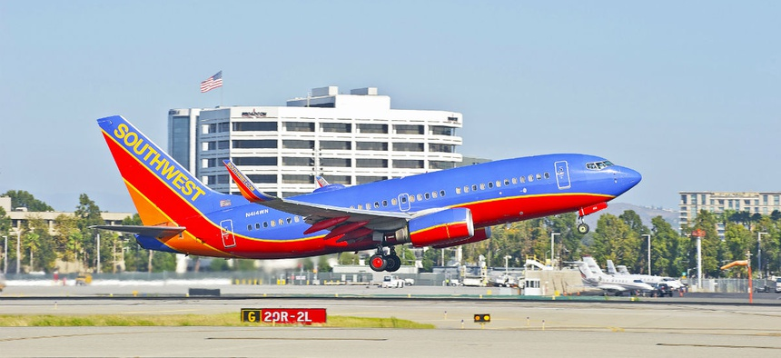 A plane takes off from the John Wayne Airport in Orange County, Calif.