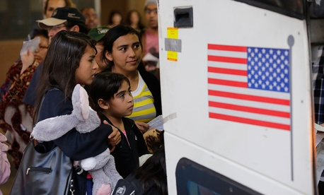 Immigrants from El Salvador and Guatemala who entered the country illegally prepare to board a bus after they were released from a family detention center in San Antonio in July.