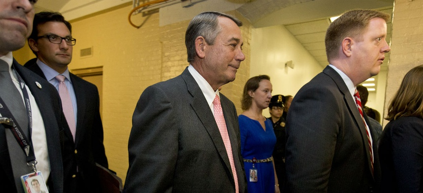 House Speaker John Boehner leaves a meeting with the House GOP on Friday. In a stunning move, Boehner informed fellow Republicans he would resign from Congress at the end of October.