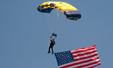 A member of the Navy parachute demonstration team jumps during the capabilities portion of the SEAL West Coast Reunion in 2012.