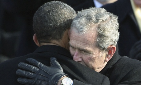 Former president George W. Bush hugs President Obama after his January 2009 swearing in.