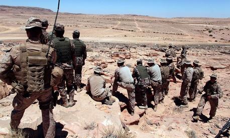 U.S. Marines observe training maneuvers in Jordan in 2013.