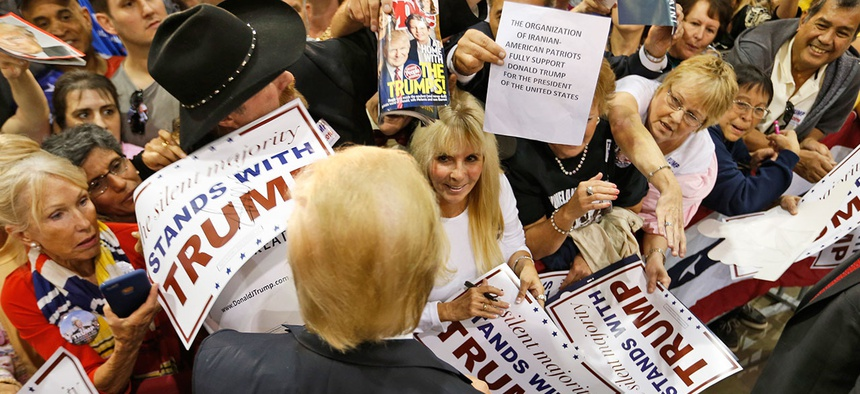 Donald Trump signs autographs for a group of supporters after a rally in Richmond, Va., on Wednesday.