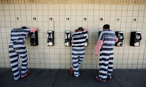 Inmates talk on pay phones in Maricopa County's jail in Arizona in 2008.