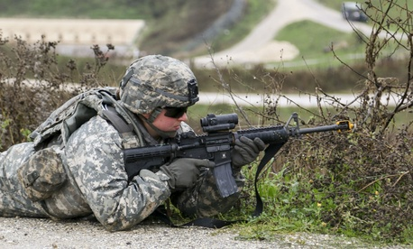 U.S. Army Spc. Felicia McCormick takes part in a training exercise in Kosovo.