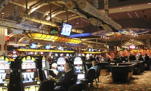 Casino players play under an handcrafted canopy at the Four Winds Casino Resort in New Buffalo, Mich.