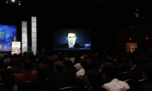 Edward Snowden spoke via videoconference with supporters at the 2015 International Students for Liberty Conference in DC in February.