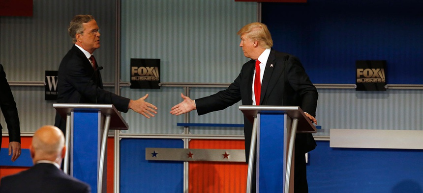 Jeb Bush and Donald Trump shake hands after the Republican presidential debate Tuesday.