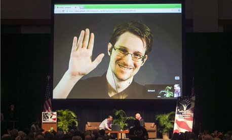 Edward Snowden appears on a live video feed broadcast from Moscow at an event sponsored by ACLU Hawaii in February.