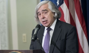 Energy Secretary Ernest Moniz speaks at a signing ceremony for a memorandum of agreement to establish the Manhattan Project National Historic Park, Tuesday, Nov. 10, 2015, at the Interior Department in Washington.