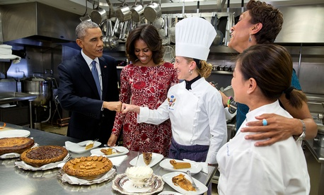 Barack Obama fist bumps Executive Pastry Chef Susie Morrison after sampling pies with First Lady Michelle Obama, ABC News Anchor Robin Roberts and Executive Chef Cris Comerford during an interview about Thanksgiving in the White House Kitchen in 2014.