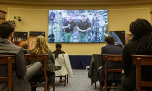 NASA astronauts Scott Kelly, Expedition 46 Commander, left, and Kjell Lindgren, Expedition 46 Flight Engineer, right, are seen from onboard the International Space Station during a House Committee on Science, Space and Technology hearing Wednesday.