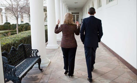 Barack Obama walks along the Colonnade of the White House with Hillary Clinton in 2011.