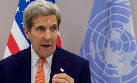 Secretary of State John Kerry addresses reporters in Paris after the climate change accord was reached.