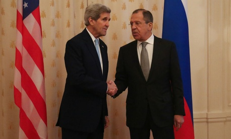 Kerry and Lavrov shake hands before their meeting.