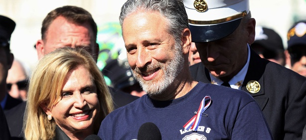 Jon Stewart, accompanied by Rep. Carolyn Maloney, D-N,Y., and New York City first responders speaks during a rally on Capitol Hill in September.