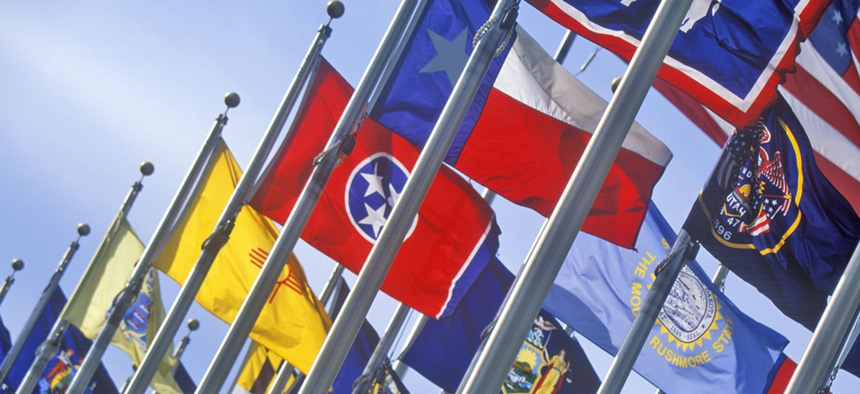 State flags fly on poles.