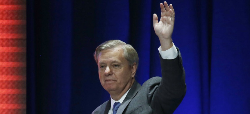 Graham waves after addressing a summit in Orlando, Fla., in November.